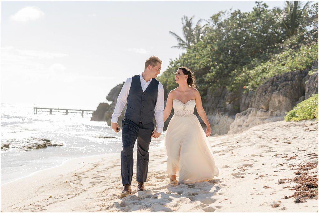 bride and groom beach wedding holding hands