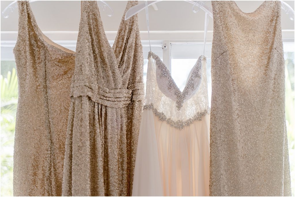 brides and bridesmaid dresses gold and white