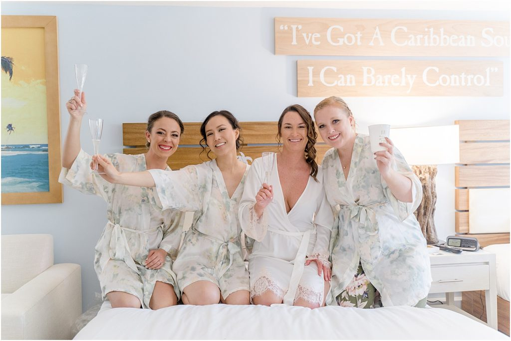 Bride and bridesmaids getting ready in floral robes