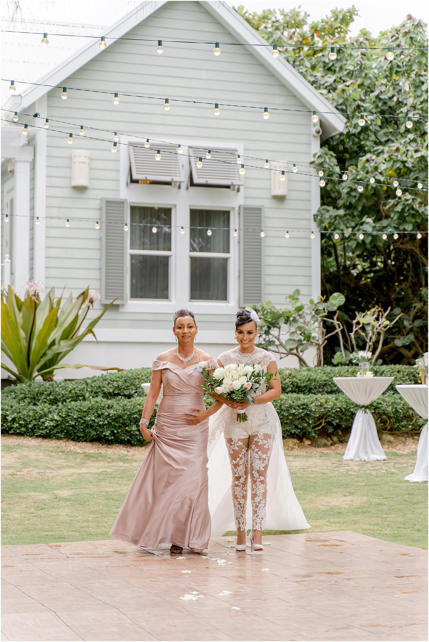 bride and mother walking down aisle at Sea Orchard Retreat