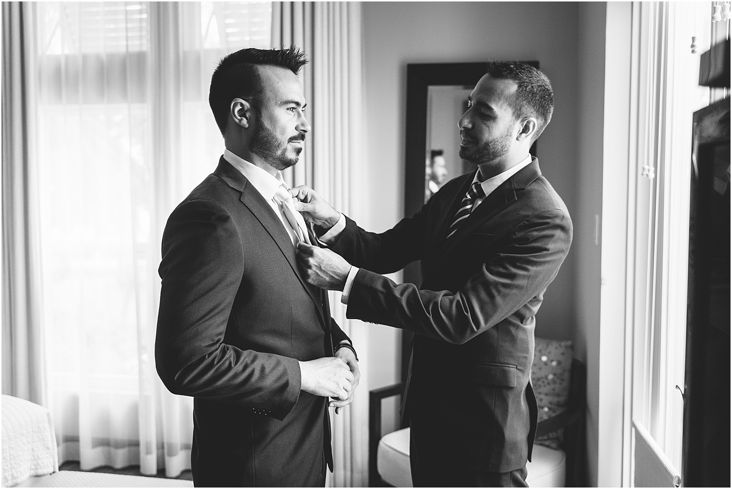 black and white, groom and groomsmen getting ready at Sea Orchard Retreat